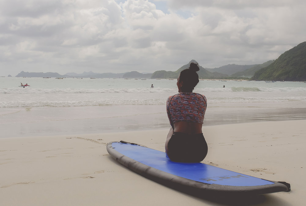 Surfer Girl on the beach Bali Yoga Retreat Lombok