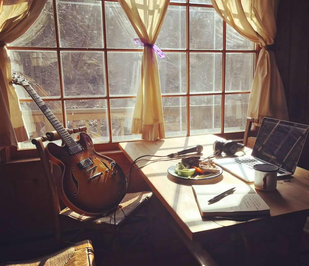 Making breakfast for one and making music for all in the cabin