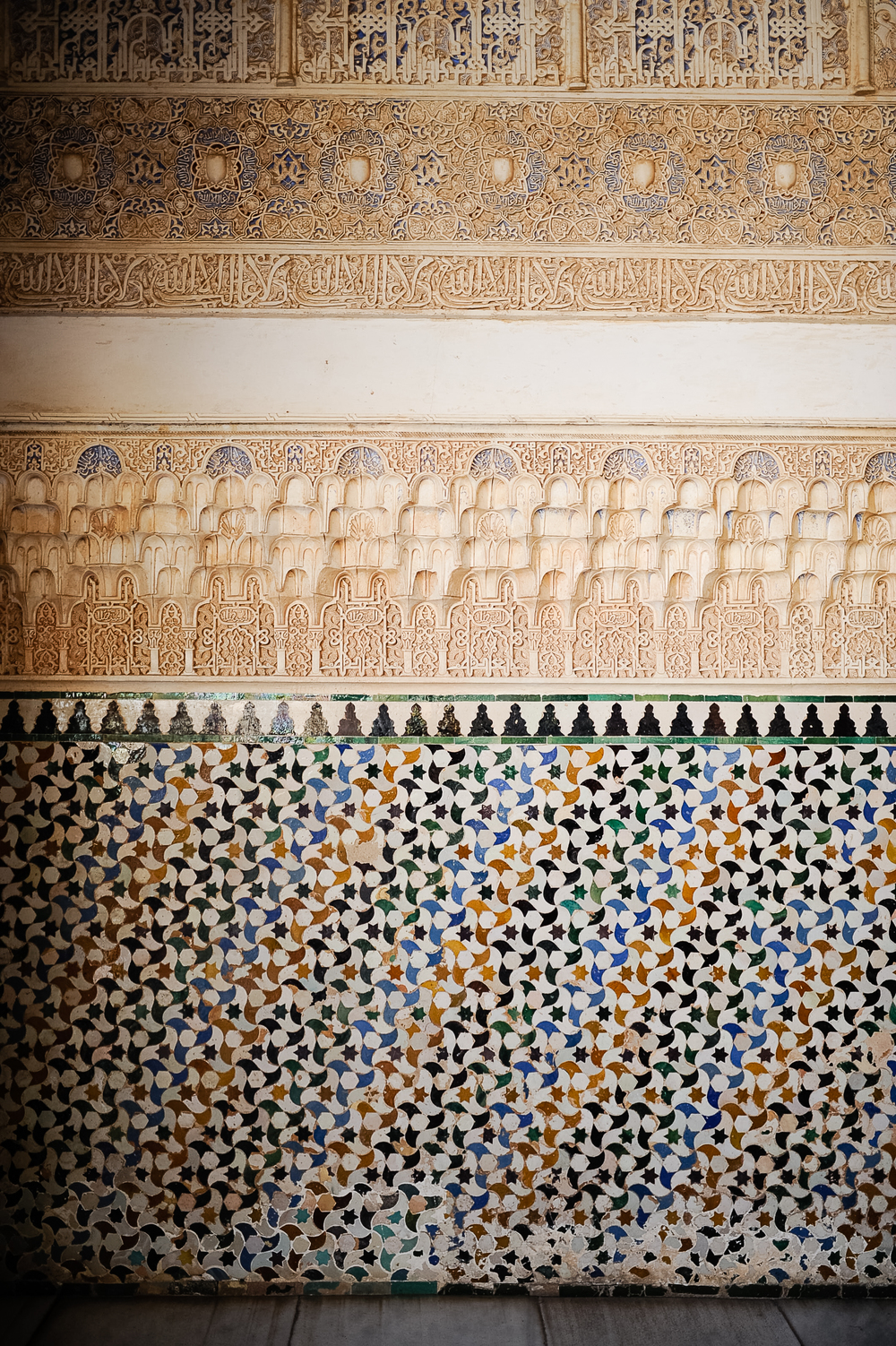 "Arabic decoration uses no animal or human figures only ""arabesque"" geometric figures and inscriptions.  Over and over, around the walls, is inscribed ""The only victor is Allah.""  (Wherever you see the slight ""W"")"