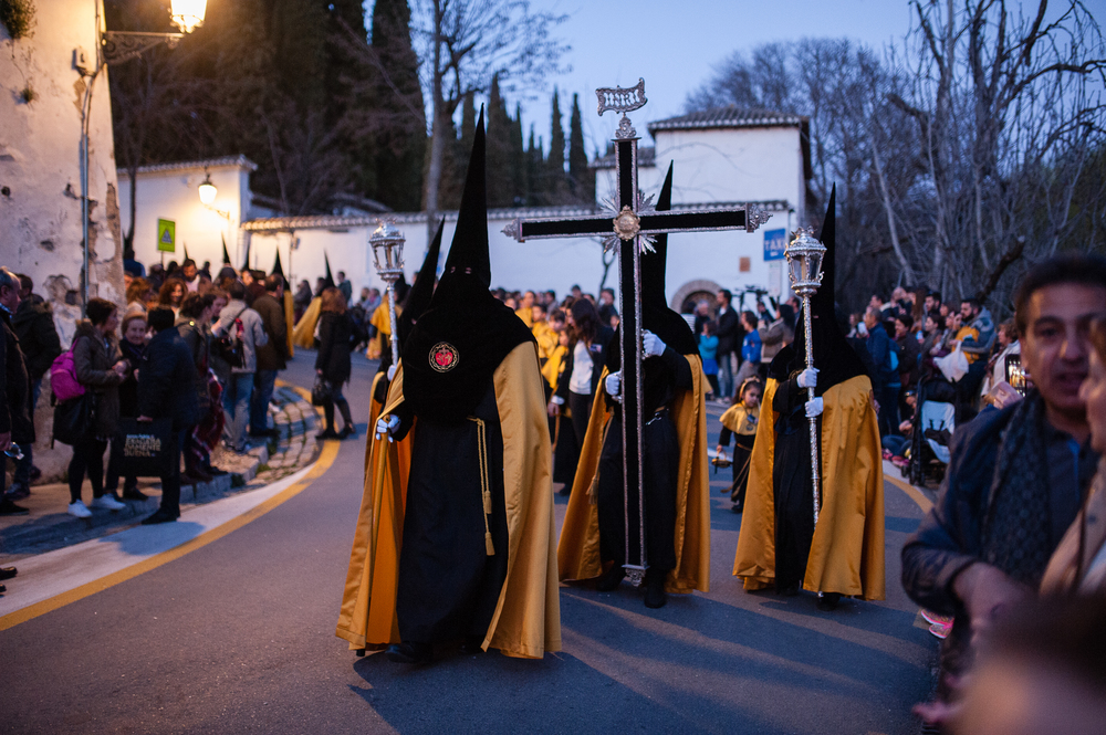 The  nazarenes  lead the penance procession. They are so chilling to Americans I think because they recall the costumes of the KKK - but these hoods actually come from medieval times when religious punishments involved wearing cone hats or hoods through the streets.