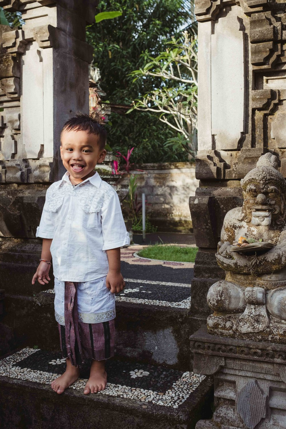 boy outside family temple