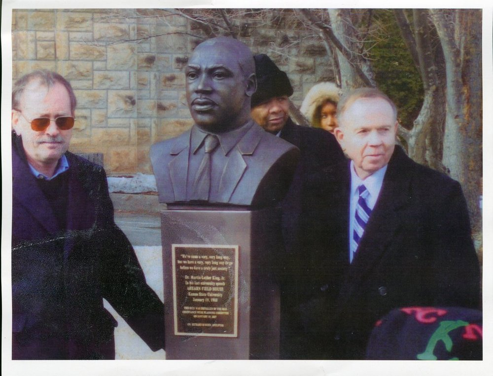 Dan Lykins unveiling a commemorative bust of Dr. King at K-State
