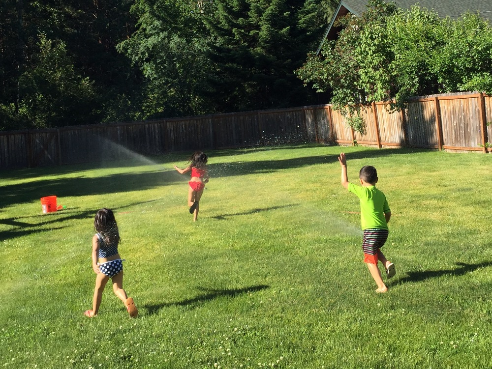 It's not summer break without running through the sprinklers