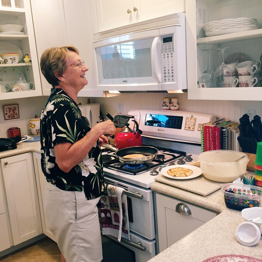 Scott's mom Grace making huckleberry pancakes for us