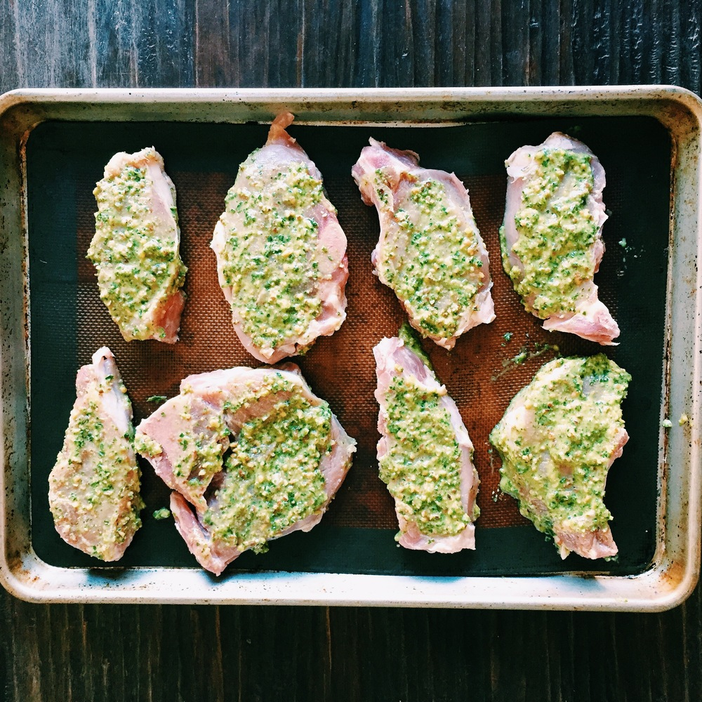 Pork chops with my homemade pesto sauce (one cup of basil, 1/4 cup of almonds, 3 cloves of garlic, salt, black pepper, and 1/2 cup of olive oil) Blend them together till all ingredients are mixed.