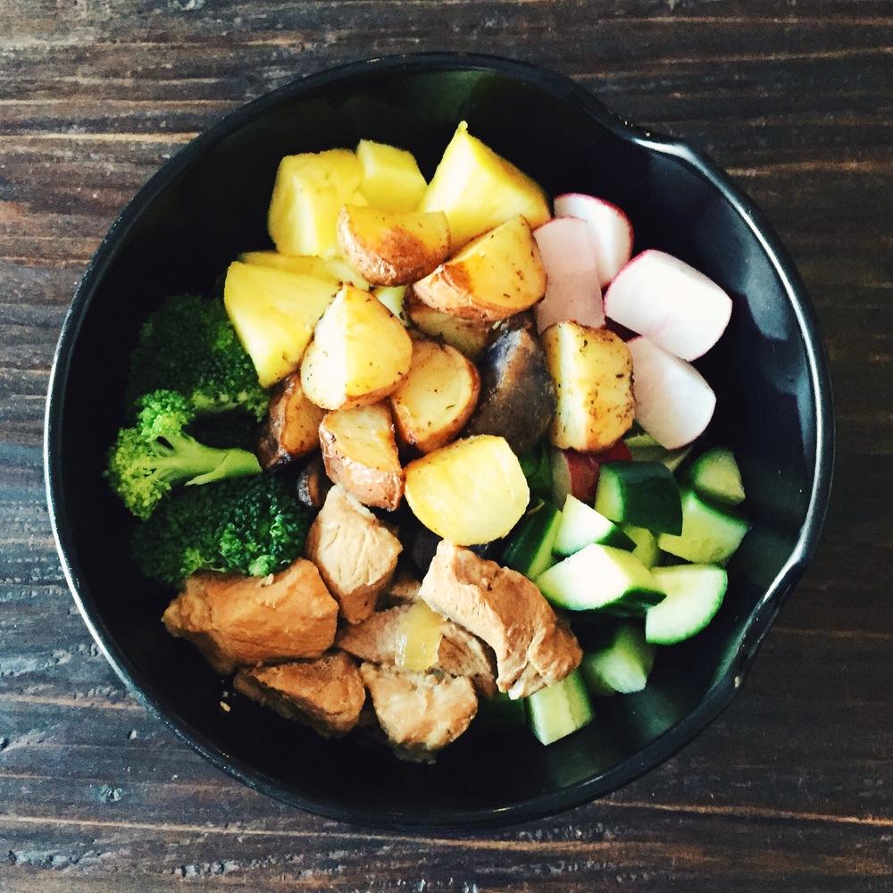 Leftover salad bowl. Steamed broccoli, diced cucumber, radish, pineapple, roasted potatoes, and pork adobo over romaine lettuce.