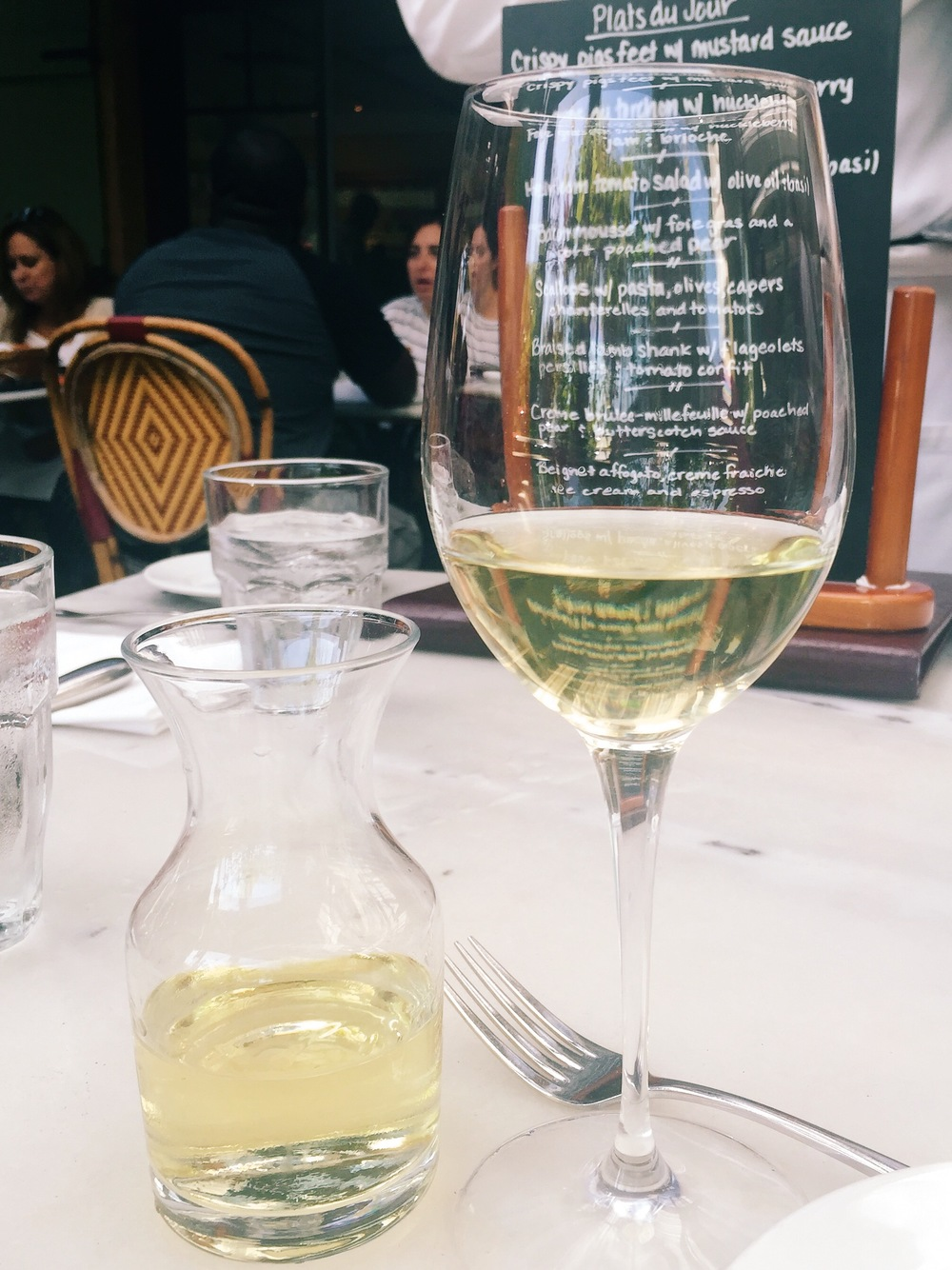 My favorite combo: a glass of excellent white wine and Bistro Jeanty.