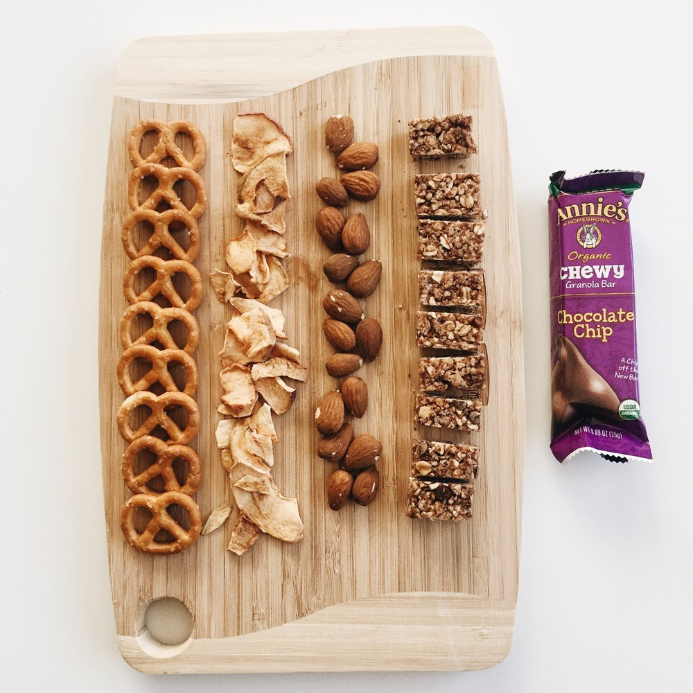 Details: pretzels, dried apple, almonds, and Annie's chewy granola bar.