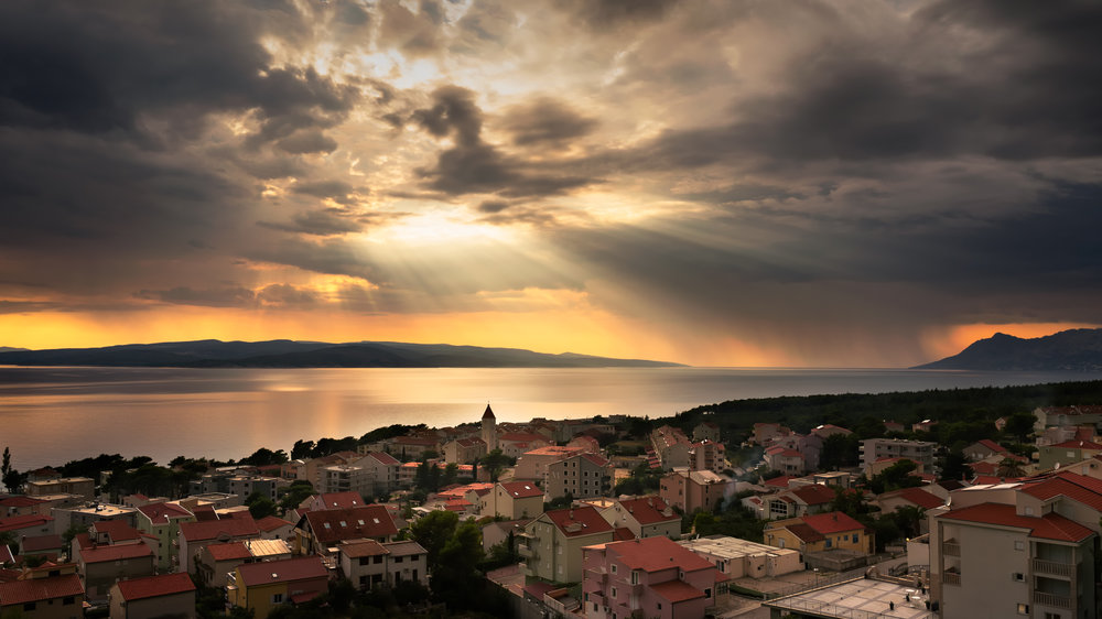 Beautiful sunset with rain clouds in Promanja - Croatia