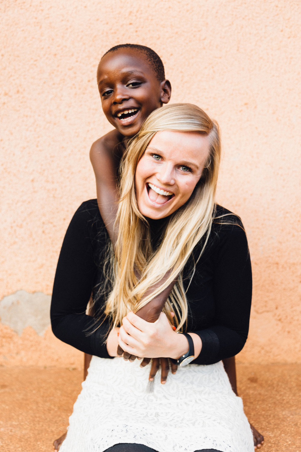 Sarah Nininger: President Sarah has been the visionary and driving force behind Action in Africa since inception, serving as the organization's President for over a decade. As President, Sarah is responsible for everything from strategic planning, fundraising, and operational execution to participating in dance classes at the Center and sleeping at the hospital when our students get malaria. Sarah has spent extensive time studying non-profit management, taking undergraduate courses on education-based non-profit strategy and volunteering for organizations like the Special Olympics and Sexual Assault Victims Services. While her broader objective is to provide students and community members with educational opportunity and social services, there has always been a special place in Sarah's heart for those with special needs. This passion, informed by personal and academic experience, has driven Sarah to institute various programs at Action in Africa tailored towards the sick and disabled, including a Women to Women Group for vulnerable women and a fund to support children with special needs. Likewise, Sarah fervently believes in the importance of personal empowerment, viewing Action in Africa as an instrument to help students realize their own potential. In particular, Sarah has focused her efforts on empowering high schoolers, working with career-oriented Ugandan professionals to put on panels for our students. By introducing students to doctors,creative artists, and entrepreneurs who grew up in villages similar to Nakuwadde and households like their own, Sarah has inspired our students to take control of their lives and dream bigger. Sarah, who writes in her journal every day, graduated from Chapman University with a degree in Integrated Educational Studies in 2012.