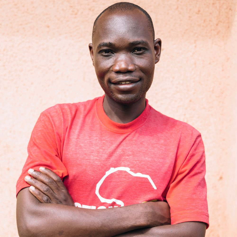Omino Benard - Security Guard Benard (or Bennet as some Ugandans call him) is 34 years old and was born in Lira where he lived until he was 10 years old, and then he lived the remainder of his life in the Kampala area. In 2010 he joined a security company which he worked in until he joined us here at Action in Africa. He found a job opportunity after his old boss found a Facebook post that Action in Africa was looking for a security guard, and his old boss was leaving Uganda, but he wanted to make sure he found his employee a new job because he believed he was such a good man.