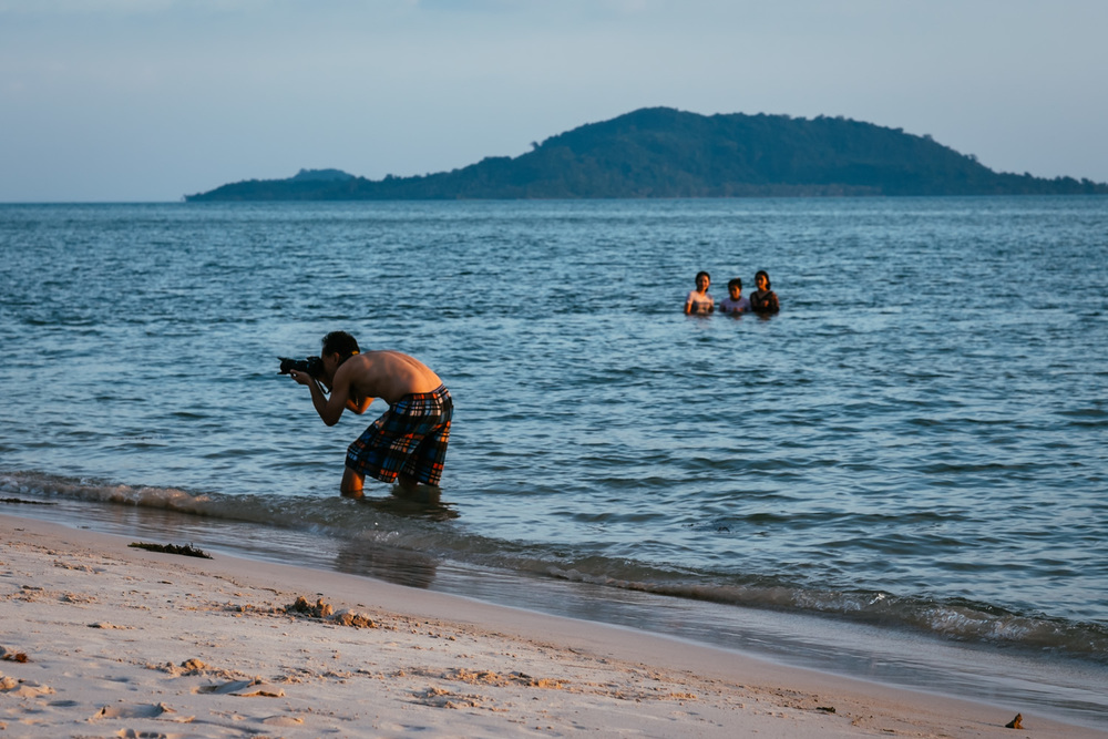 A tourist photographing in Kep, Cambodia