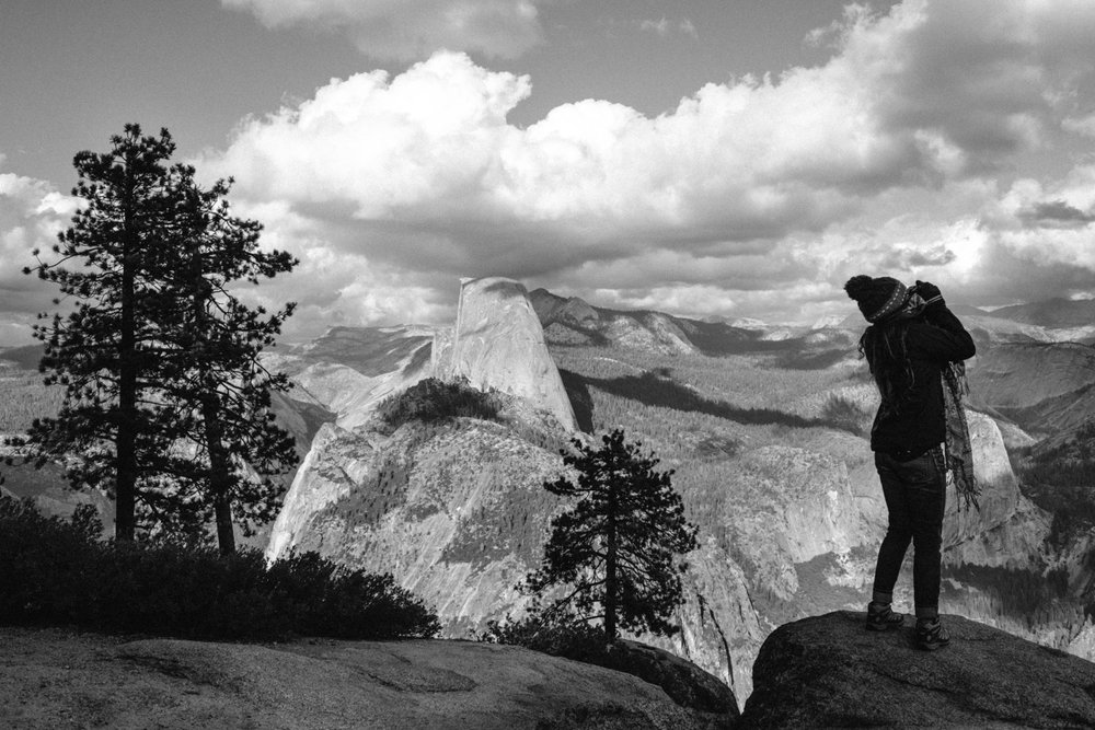 Ale   photographing with my  X100S , with the impressive  Half Dome  in the background