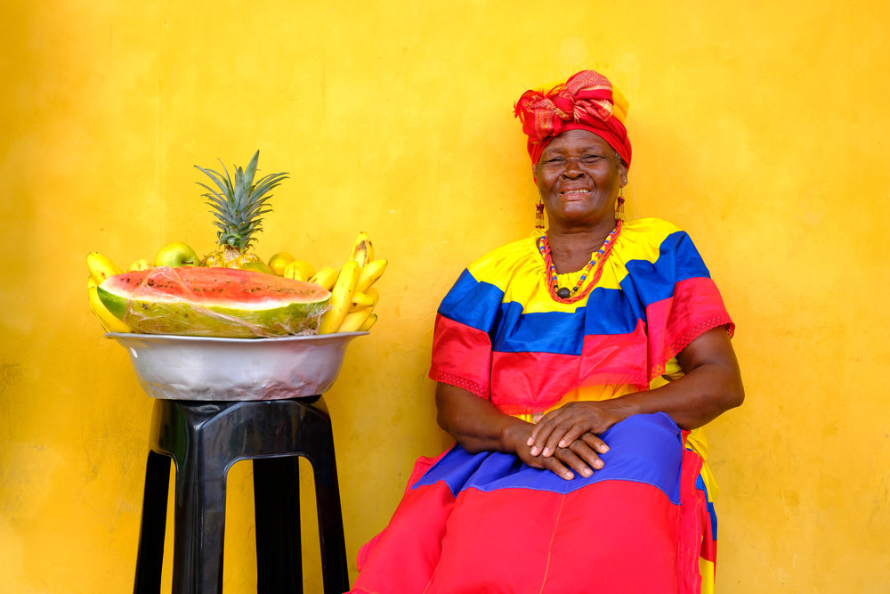 "A ""Palenquera"" posing for a portrait in the historic center of Cartagena de Indias, Colombia"