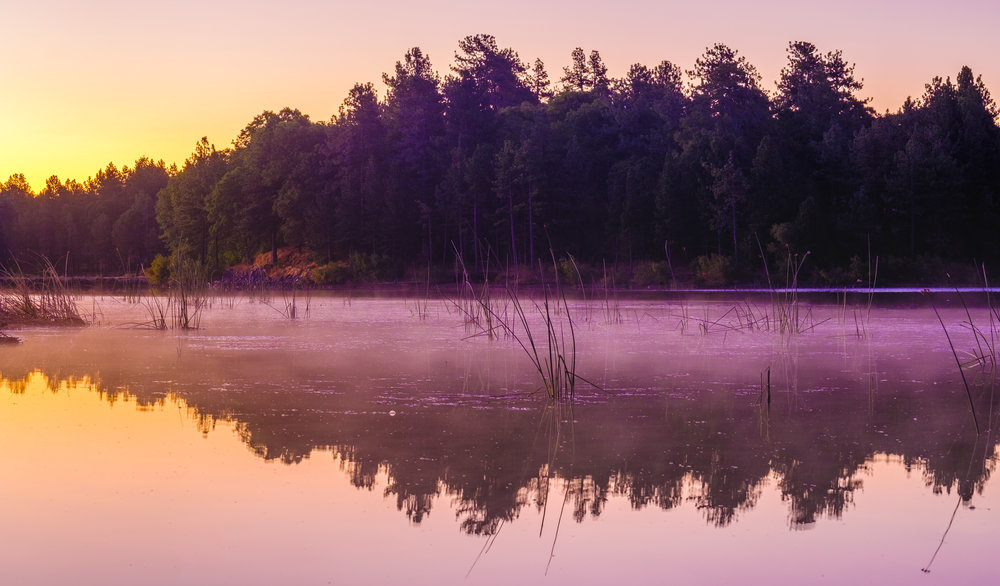 Pinkish colors and a steam fog dancing over the lake