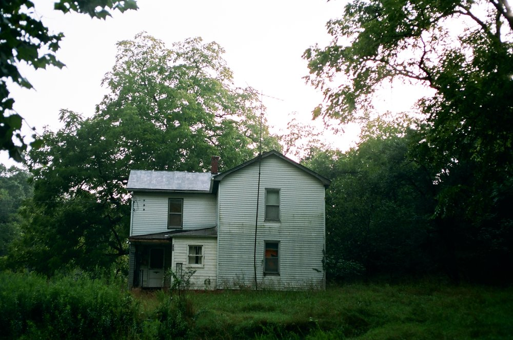 Drenched home as it starts to clear after the storm on Kodak Portra 400
