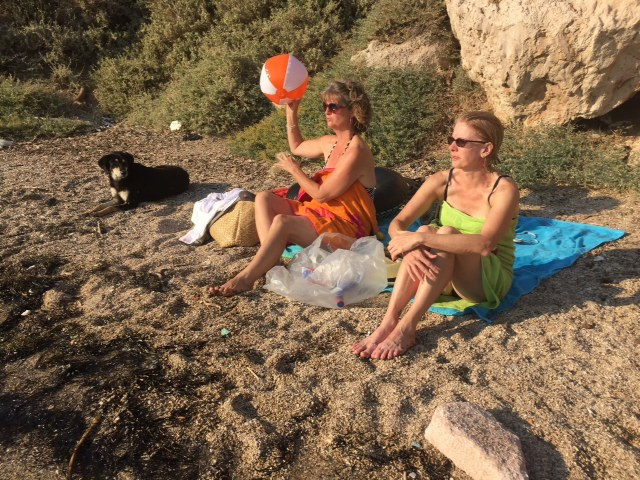 This pup joined Morgan and Gretl at their towels.  Out of the shot, is cat sleeping on my towel as Greg and I snorkel.