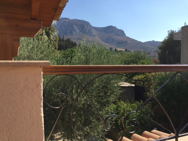 The view from Greg's office passageway.   Acrocorinth  on top the mountain is clearly seen in the distance.