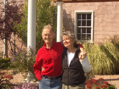 married to each other and to the idea that great food and wine go together, Joe Will (STREWN COFOUNDER) and jane langdon are shown in front of the winery and cooking school.