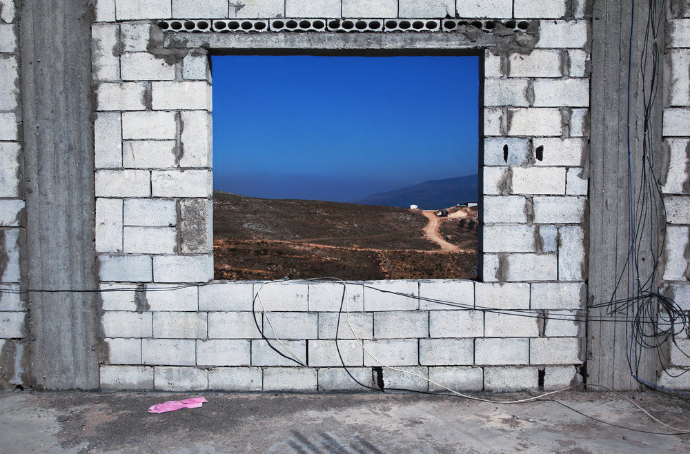 "Wall  ,  2014, vinyl wallpaper (photograph taken in Marjayoun, Lebanon, 2013), 96""x 144"" (243.8 cm x 365.8 cm)"