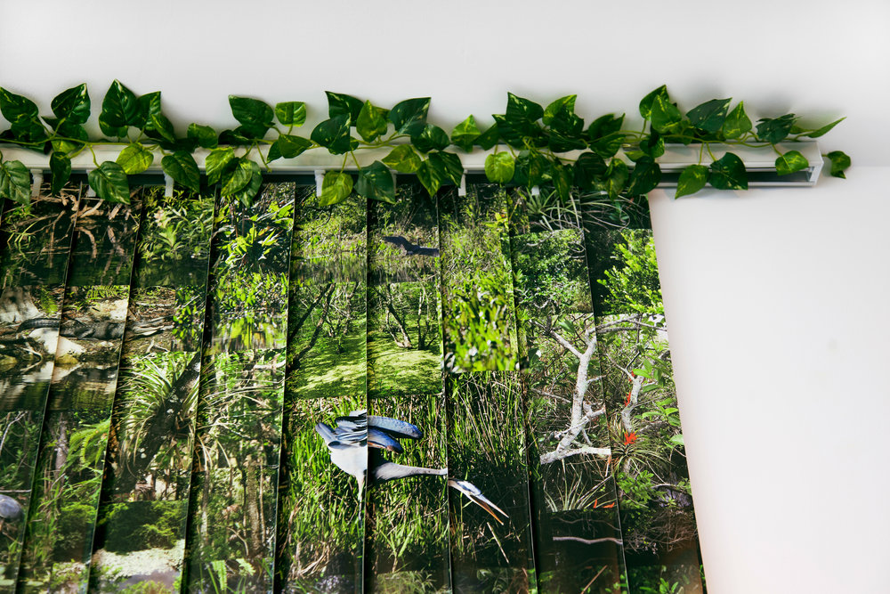 "Everglades , detail, 2014, vinyl wallpaper, vertical blind, artificial vines, 78""x 84"" (198.1 cm x 213.4 cm)"