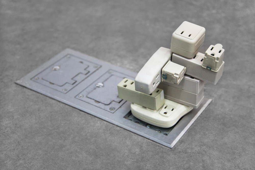 "Plugin Adapter , 2014, outlet adapters, 3""x 3""x 4""(7.6 cm x 7.6 cm x 10.2 cm)"
