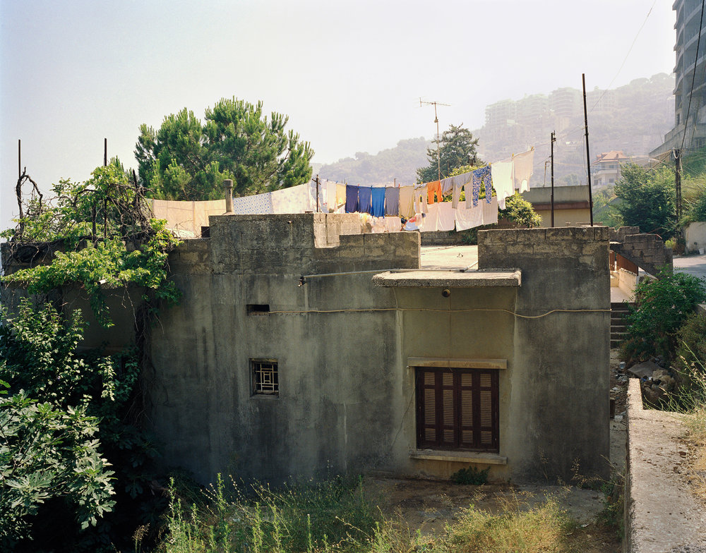"A series of photographs taken in Beirut, Lebanon, Miami, Florida and Brooklyn, New York,  Stills  simply aims to draw similarities in urban life. Objects arranged in everyday scenes are given importance or reconsidered, and the resulting images are intended to look like abandoned film sets.    Clothes Drying   Beirut, Lebanon, 2007, 20""x 24"", chromogenic print"