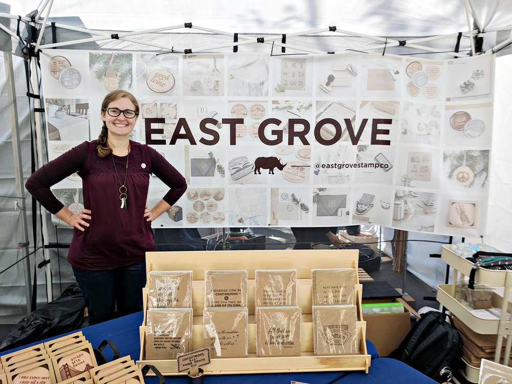 Sydney Musselman from East Grove Stamp Co. inside her craft show booth at The Renegade Craft Fair in Chicago