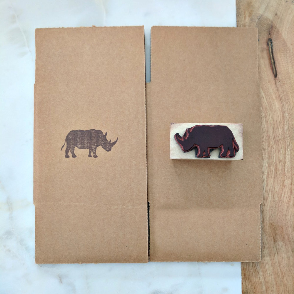 Boxes - We stamp all of our boxes with the rhino icon from our logo. We like highlighting our icon on packaging elements when we know our logo will be seen inside.