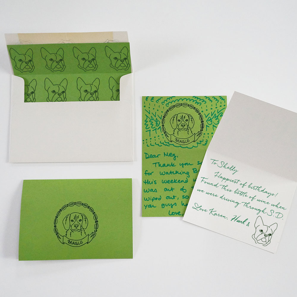 DIY your own stationery that features your pup(s). Make simple folded cards with a  dog+border stamp  on the outside (lower left), quirky flat cards by adding some of your own doodles across the top of the card (middle), or unexpected envelope liners using just a  dog portrait without the border  stamp (upper left).  Instead of inking your dog's paw every time he needs to 'sign' a card, add a dog  portrait stamp  as his 'seal of approval'. Less mess when he slips away with an inky paw and runs through your house!