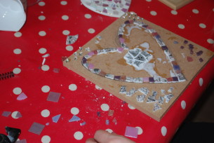 Rebecca starts by mosaicing the edge of the heart