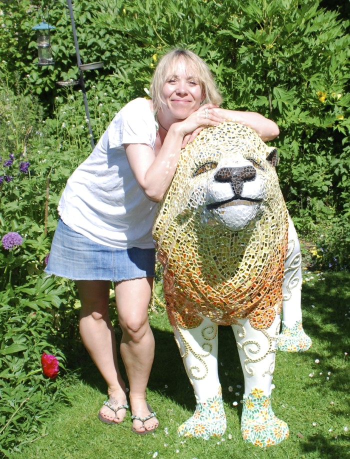 Mosaic Artist with mosaic lion