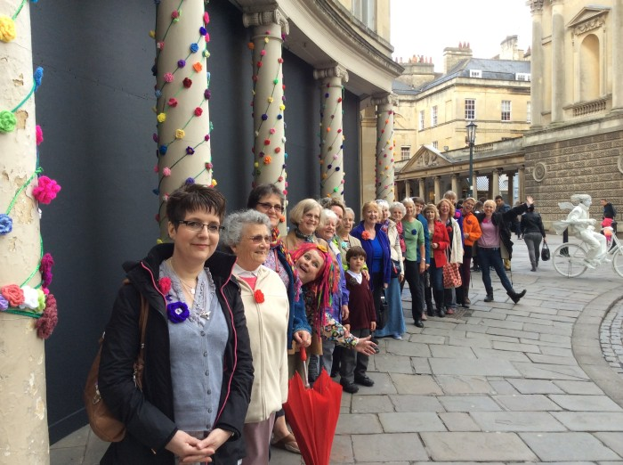 Rose Yarnbomb Bath in Fashion 2014. Crochet roses adorning colonnades in Bath city centre