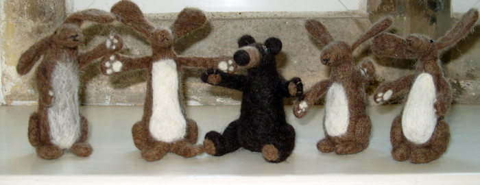 5 needle felted Hares and Bears all in a row