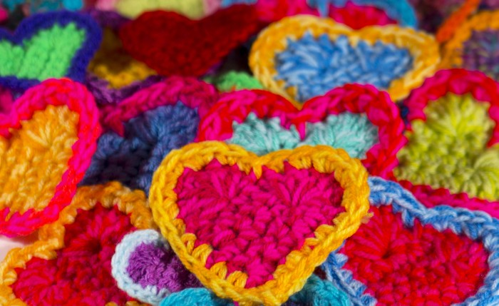 Close up of pink and yellow crochet heart