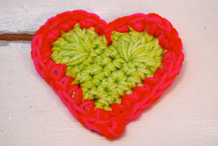 Close up of green and red crochet heart