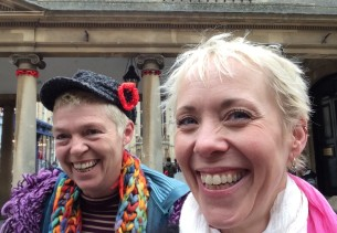 Selfie of two happy ladies with their crochet poppies