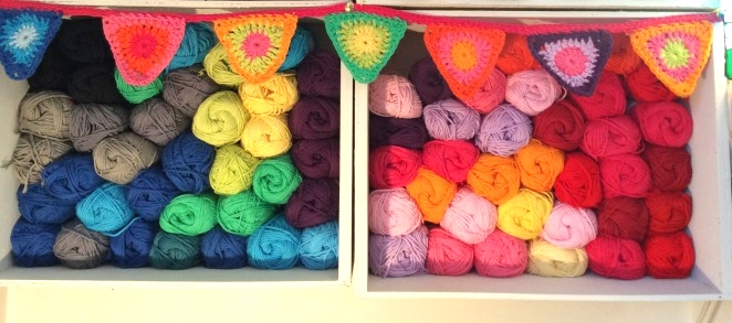 Colourful wool display with crochet bunting