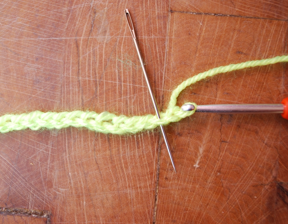 Into the second chain from hook work 3 double crochet (US=Single crochet)