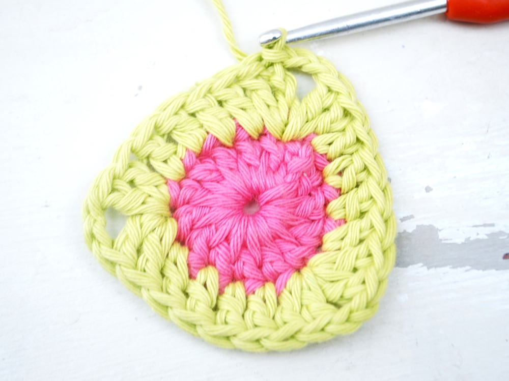 Into next stitch work 2 treble crochet and chain 2.  Using a slip stitch join into 3rd chain and cast off this colour.