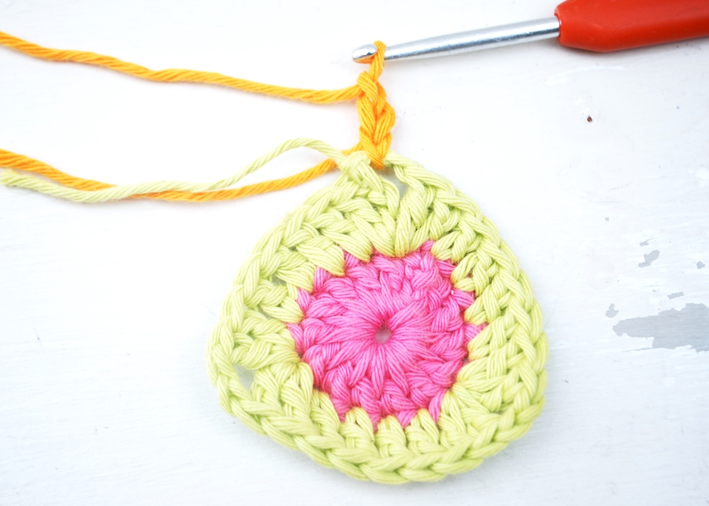 Join your 3rd colour (tangerine) and work a chain 3.  This counts as your first treble crochet.