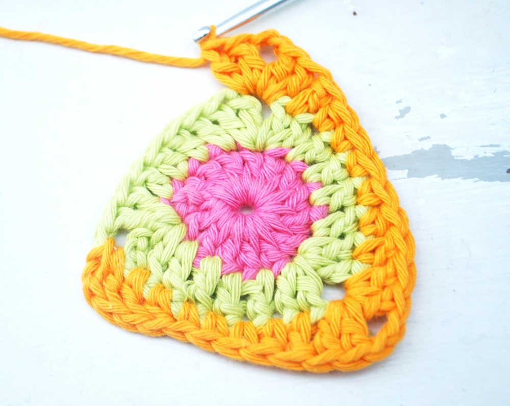 Work into each of the following stitches as follows: * 1 treble crochet, 1 half treble, 1 double crochet, 1 double crochet, 1 double crochet, 1 half treble, 1 treble crochet **.  This takes you to the 2nd corner (2 treble crochet, chain 2 and 2 treble crochet all into same hole)  Repeat from * to **