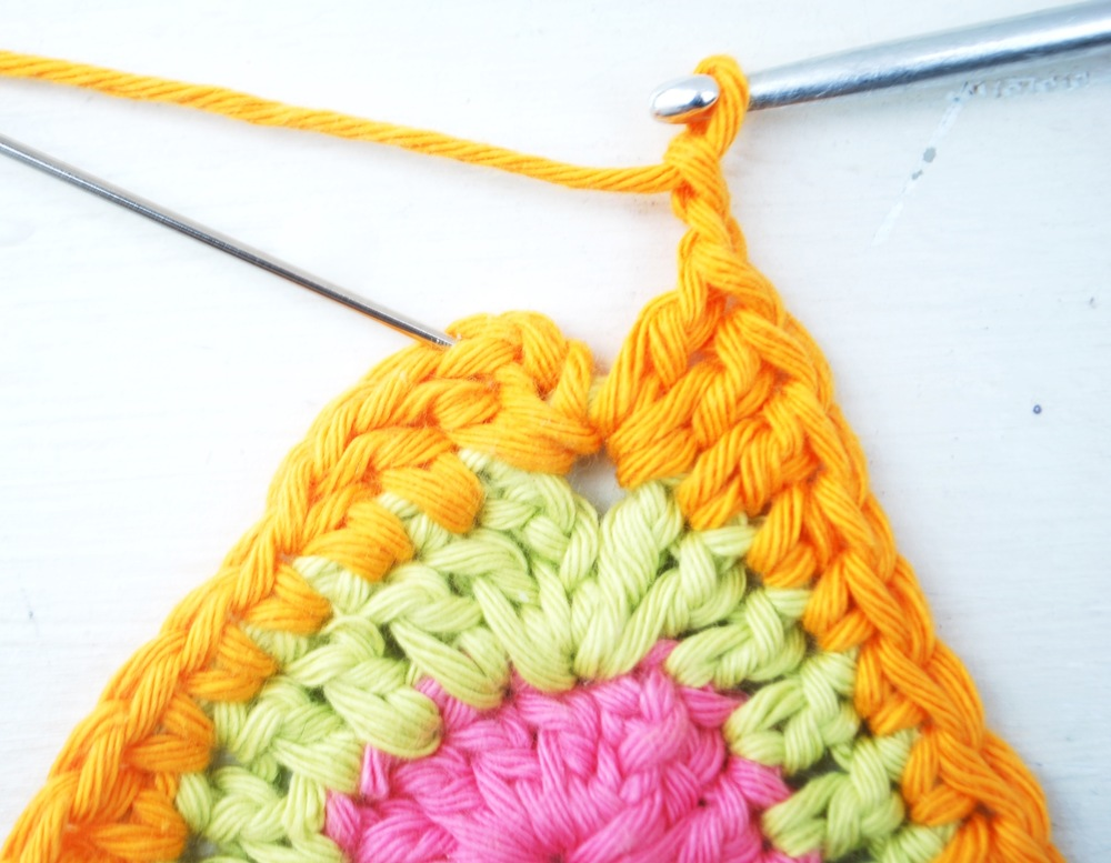 Into next stitch work 2 treble crochet, chain 2 and join into 3rd chain with a slip stitch.  Cast off.