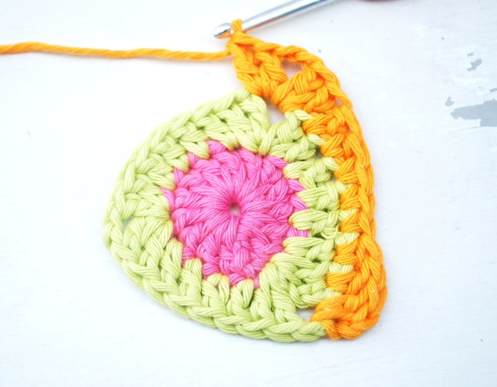 Into next stitch work a corner as follows: 2 treble crochet, chain 2 and 2 treble crochet all into same stitch.