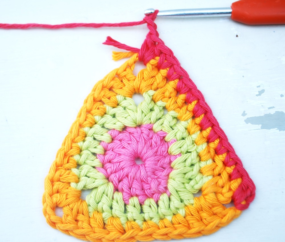 Work 1 double crochet into each stitch (10 in total) until you reach the next corner.  Work 2 half trebles and chain 2