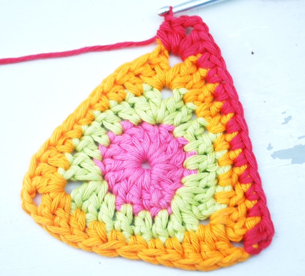 Work 2 more half trebles into same stitch.  This completes your first corner.