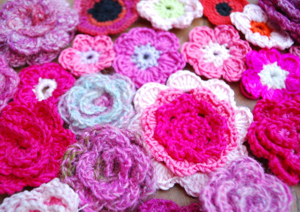 Assortment of pink crochet flowers.JPG