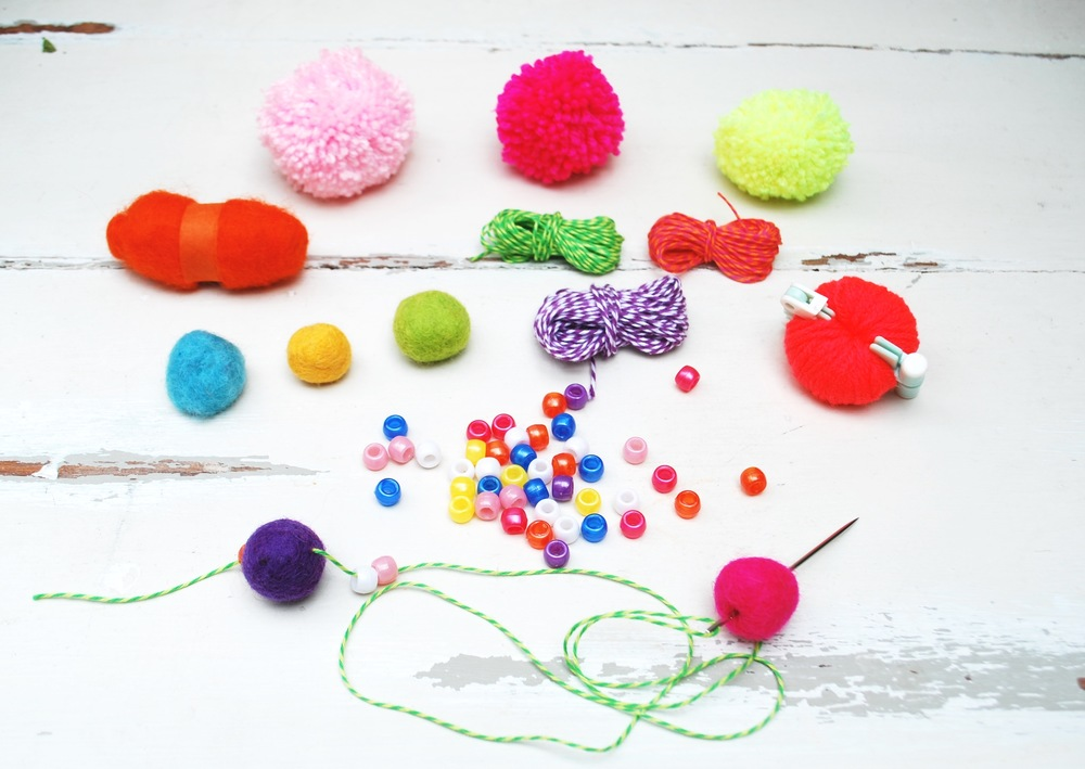 Contents of pom pom curtain kit.  Felt balls, beads and twine