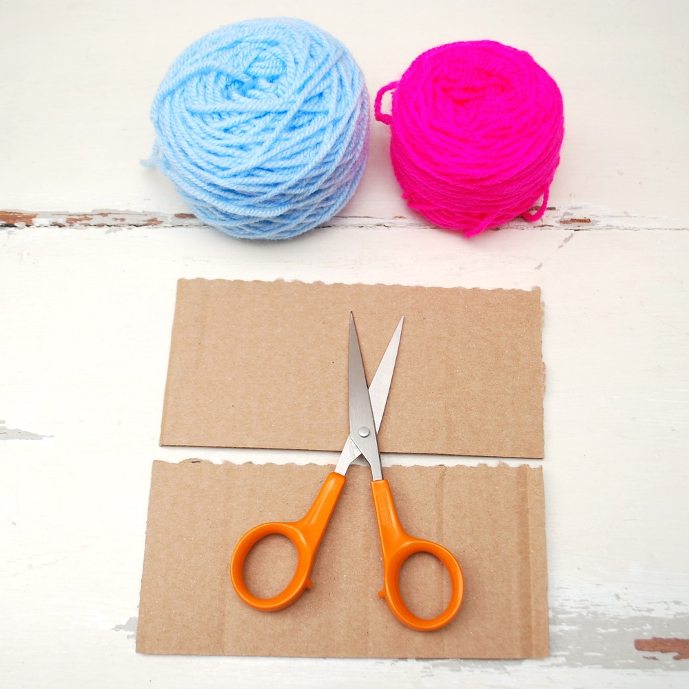 All you need are two pieces of card, a pair of scissors and some colourful wool.