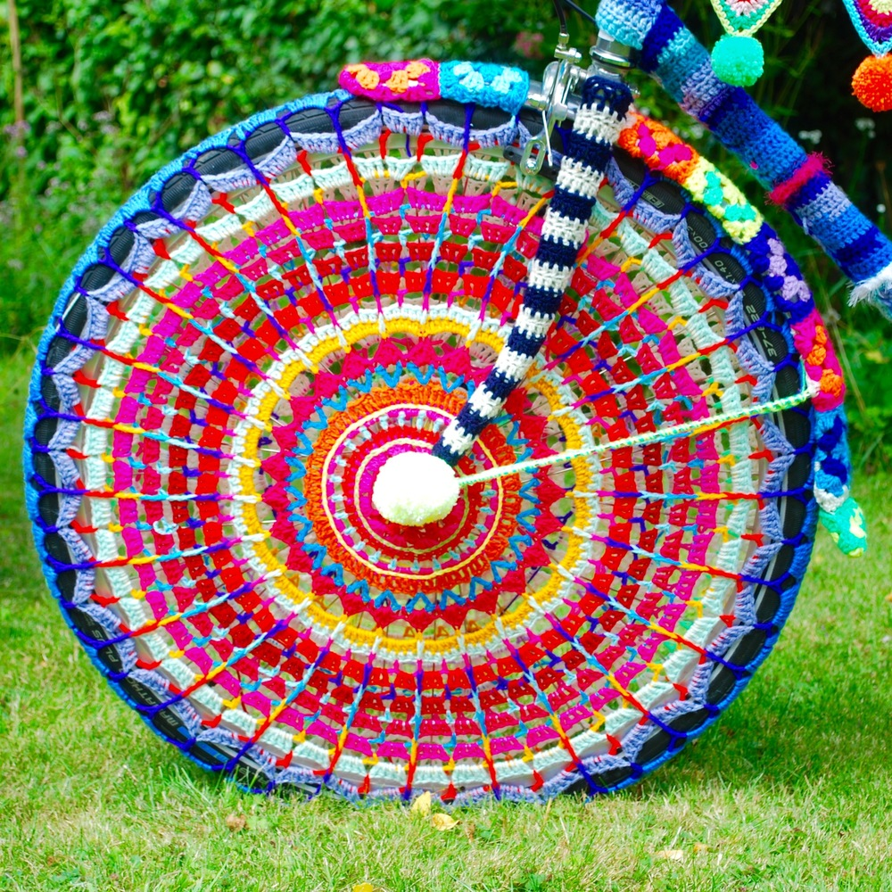 Reverse side of crochet wheel for yarn bomb bike by Emma Leith